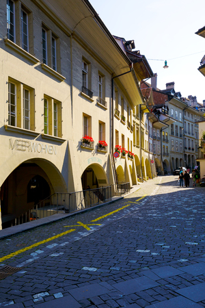 arcades: BERN, SWITZERLAND - SEPTEMBER 13, 2015: Arcades along the narrow street in downtown. The total length of the arcades in the city is estimated at 6 km
