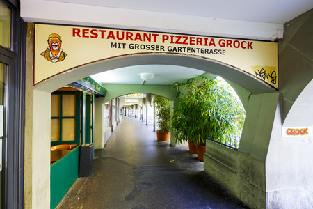 BERN, SWITZERLAND - SEPTEMBER 13, 2015: Restaurant pizzeria Grock advert in the famous arcades. The total length of the arcades in the city is estimated at 6 km