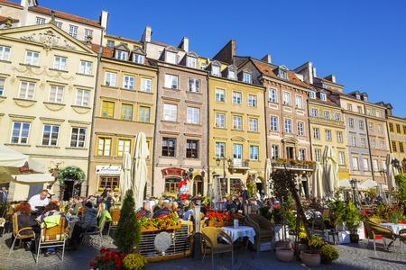 townhouses: WARSAW, POLAND - OCTOBER 10, 2015: Townhouses at the Old Town square on the side of Barssa, completely destroyed during World War II and reconstructed in the years 1949-1953
