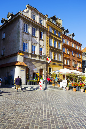townhouses: WARSAW, POLAND - OCTOBER 10, 2015: Townhouses, Castle Square in the Old Town detail, destroyed up to the basement during World War II, rebuilt in the years 1949-1958