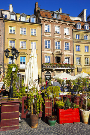 municipal editorial: WARSAW, POLAND - OCTOBER 10, 2015: Townhouses at the Old Town square on the side of Barssa detail, completely destroyed during World War II and reconstructed in the years 1949-1953