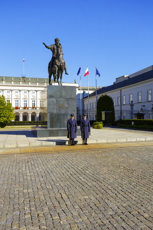 municipal editorial: WARSAW, POLAND - OCTOBER 10, 2015: An honor guard at the monument of Prince Jozef Poniatowski in front of the courtyard of the Palace, the official residence of the President of the Republic of Poland Editorial
