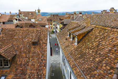 linguistic: MURTEN MORAT, SWITZERLAND - SEPTEMBER 15, 2015: A view towards city roofs, seen from Town Rampart Walls, in the city with a population of approx. 6500 citizens. German and French linguistic region