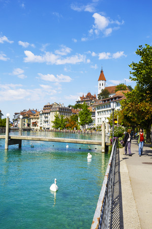 approx: THUN, SWITZERLAND - SEPTEMBER 08, 2015: River Aare and the Town of Thun. Thun with a population of approx. 45000 citizens it is a city located in the canton of Bern, situated on the River Aare