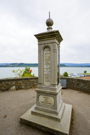 geographic: MURTEN MORAT, SWITZERLAND - SEPTEMBER 15, 2015: Column indicating constants geographic data for Murten Morat, was built in 1903 by the Tourist Office