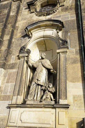commissioned: DRESDEN, GERMANY - SEPTEMBER 19, 2015: Sculpture adorned the facade of the Cathedral of the Holy Trinity, former church of Royal Court of Saxony, , the church was commissioned by Augustus III