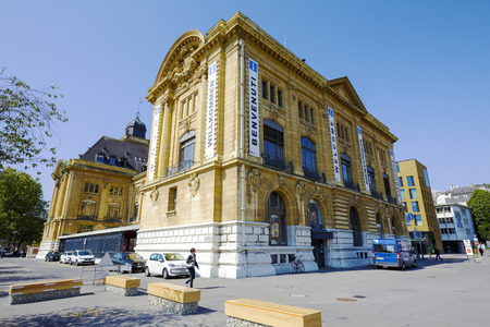 postes: NEUCHATEL, SWITZERLAND - SEPTEMBER 09, 2015: Massive building, the seat of Post Office and the Tourist Information Office, the building is also well known as a Hotel des Postes Editorial