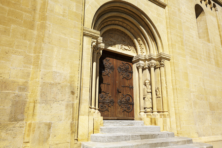 collegial: NEUCHATEL, SWITZERLAND - SEPTEMBER 09, 2015: The side door to the Collegiate Church. The church was built in the 12th century, then expanded