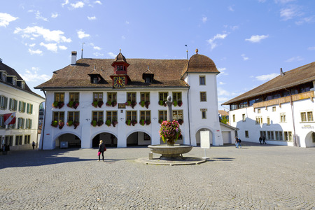 tenement: THUN, SWITZERLAND - SEPTEMBER 08, 2015: The Town Hall Rathaus building was built around 1500, the current building dates back to 1685, the current appearance received after total renovation in 1964