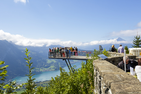 interlaken: INTERLAKEN, SWITZERLAND - SEPTEMBER 07, 2015: The viewing platform placed on altitude of 1322m at Harder Kulm, provides scenic views of the city, two lakes, the river Aare and beautiful alpine peaks