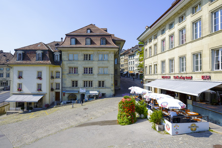 linguistic: FRIBOURG, SWITZERLAND - SEPTEMBER 10, 2015: Urban scene of architecture in the capital city of the canton of Fribourg, which shares two linguistic regions between German and French cultures Editorial