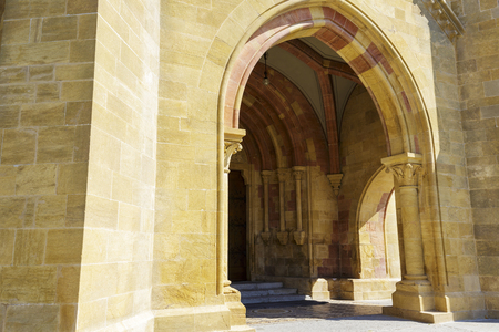 collegial: NEUCHATEL, SWITZERLAND - SEPTEMBER 09, 2015: The entrance to the Collegiate Church. The church was built in the 12th century, then expanded