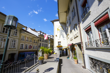 approx: THUN, SWITZERLAND - SEPTEMBER 08, 2015: A general view of one of the narrow streets of the city of Thun with a population of approx. 45000 residents, it is a city located in the Canton of Bern