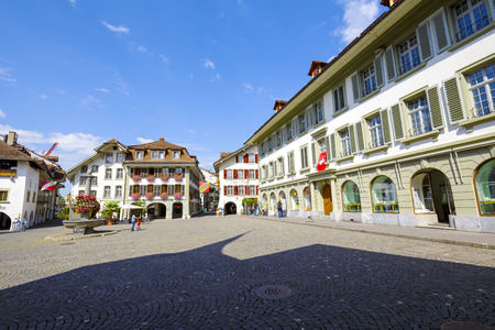 town hall square: THUN, SWITZERLAND - SEPTEMBER 08, 2015: Historic buildings surrounding The Town Hall Square. It is the historic centre of the city, name after the town hall built in 1500 at this square