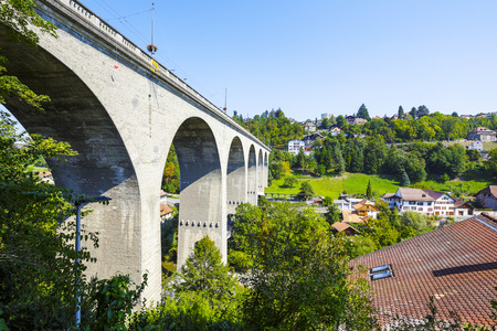 linguistic: FRIBOURG, SWITZERLAND - SEPTEMBER 10, 2015: Zaehringen Bridge. The bridge is 165m long and spans both sides of the river Sarine which shares two linguistic regions between German and French cultures Editorial