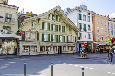 noting: INTERLAKEN, SWITZERLAND - SEPTEMBER 07, 2015: This historic house is the oldest house on Hoeheweg Alley. One of the historical and cultural treasures that are worth noting, being in the city Editorial