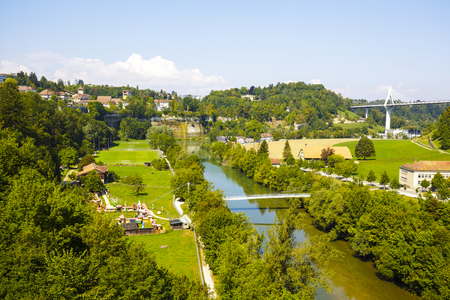 linguistic: FRIBOURG, SWITZERLAND - SEPTEMBER 10, 2015: Landscape of green areas of the city, located on both sides of the river Sarine which shares two linguistic regions between German and French cultures