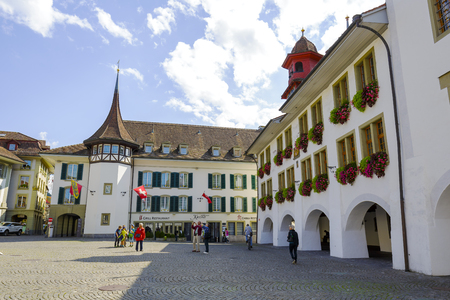 guild hall: THUN, SWITZERLAND - SEPTEMBER 08, 2015: Former guild house under the name House of Pfistern Pfister, now the Hotel Krone located on The Town Hall Square in the historic center of the city