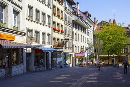 linguistic: FRIBOURG, SWITZERLAND - SEPTEMBER 10, 2015: Urban scene of architecture of the capital city of the canton of Fribourg, which shares two linguistic regions between German and French cultures