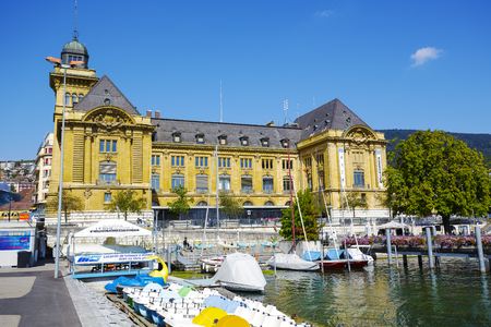 postes: NEUCHATEL, SWITZERLAND - SEPTEMBER 09, 2015: Massive building by the port, the seat of Post Office and the Tourist Information Office, the building is also well known as a Hotel des Postes Editorial