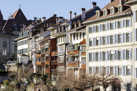 townhouses: BERN, SWITZERLAND - DECEMBER 26, 2015: The outer townhouses of the medieval Old Town. The Capital City of Switzerland it is the 4th most populous city in Switzerland Editorial