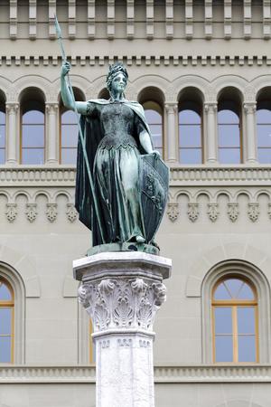 helvetia: BERN, SWITZERLAND - DECEMBER 23, 2015: Female Statue of Berna placed on the top of  Berna Fountain Bernabrunnen This female figure personifies the city of Bern, like Helvetia personifies Switzerland