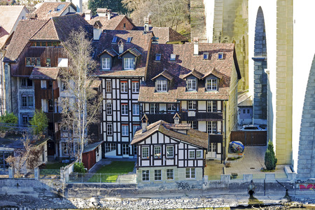 half timbered house: BERN, SWITZERLAND - DECEMBER 26, 2015: Half-timbered houses in the historic center of the Old Town. These picturesque houses are placed next to the Nydeggbruecke bridge at the river Aare