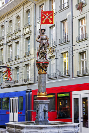dated: BERN, SWITZERLAND - DECEMBER 22, 2015: Musketeer Schutzenbrunnen fountain, dated on 16th century, located at Marktgasse. The city of Bern is worldwide known for its 16th century fountains Editorial