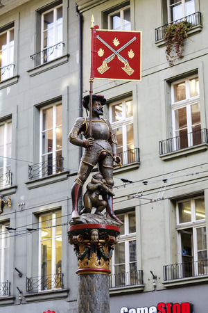 musketeer: BERN, SWITZERLAND - DECEMBER 22, 2015: Musketeer Schutzenbrunnen fountain, dated on 16th century, located at Marktgasse. The city of Bern is worldwide known for its 16th century fountains Editorial
