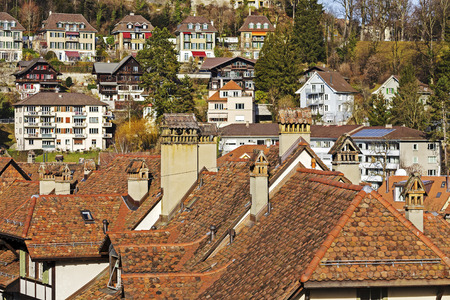 approx: BERN, SWITZERLAND - DECEMBER 22, 2015: Roofs and townhouses of the city, Bern with a population of approx. 140000 citizens it is the fourth most populous city in the country Editorial