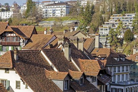 tenement buildings: BERN, SWITZERLAND - DECEMBER 22, 2015: A view towards city roofs of the Old Town of Bern, The historic old town in the central part of the city is listed as UNESCO World Heritage Site since 1983 Editorial