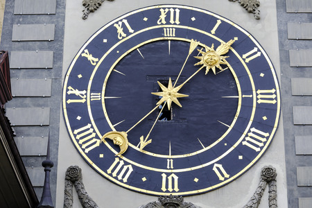 back gate: BERN, SWITZERLAND - DECEMBER 22, 2015: Massive clockface of Zytglogge, its general layout is dated back to 1770. It is on the first western gate of the city 1191 - 1256, famous tourist attraction Editorial