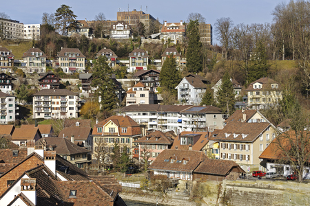townhouses: BERN, SWITZERLAND - DECEMBER 22, 2015: The outer townhouses of the medieval Old Town. The Capital City of Switzerland it is the 4th most populous city in the country