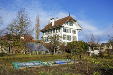 documented: BERN, SWITZERLAND - DECEMBER 23, 2015: Wittigkofen Palace, the first time documented in the 13th century, placed at Murifeld, was originally built as a residence for a farm Editorial