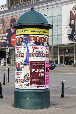 agglomeration: Warsaw, Poland - February 28, 2016: Advertising column placed next to shopping malls. An advertising column presents posters and billboards on it. Advertising pillar is one way of outdoor advertising Editorial