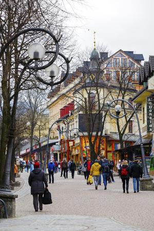 samuel: ZAKOPANE, POLAND - MARCH 07, 2016: Leisten House. Brick house built in 1900 by Samuel Leisten as a hotel at Krupowki street, the main shopping area and pedestrian promenade in the city