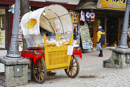 oscypek: ZAKOPANE, POLAND - MARCH 09, 2016: Sales of Oscypek cheeses and other regional food products at Krupowki street, since February 02, 2007 oscypek is Polish regional product protected by EU law Editorial
