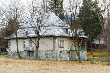 20th century: ZAKOPANE, POLAND - MARCH 09, 2016, Brick villa is a dwelling house built in the first quarter of the 20th century, stone foundation and sloping roofs refer to the architectural style of the region