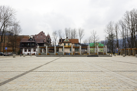 municipal editorial: ZAKOPANE, POLAND - MARCH 07, 2016: View over the Independence Square towards famous and historical buildings, the whole square revitalization was completed in 2013