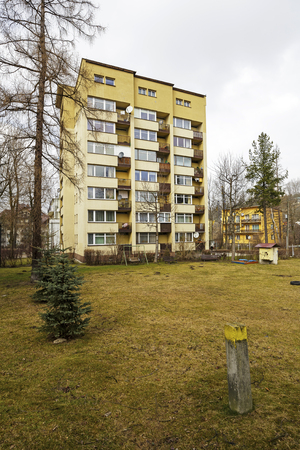 multifamily: ZAKOPANE, POLAND - MARCH 08, 2016: Multi-family residential building constructed in the rapid and economical project realization is made of the finished constructional components, was built in 1965