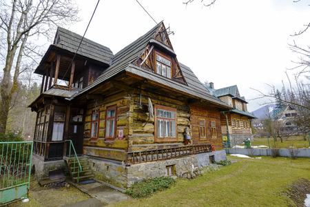 tatra: ZAKOPANE POLAND - MARCH 08, 2016: Old residential house made of wood built ok.1920 year is registered in the municipal register of architectural monument Editorial