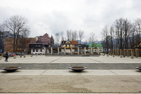 zakopane: ZAKOPANE, POLAND - MARCH 07, 2016: View over the Independence Square towards famous and historical buildings, the whole square revitalization was completed in 2013