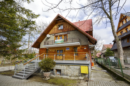 accomodation: ZAKOPANE, POLAND - MARCH 09, 2016: Holiday House called Sienkiewiczowka 2, building with elements of Zakopane style, offers accomodation for tourists coming to town