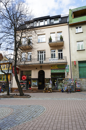 tenement buildings: ZAKOPANE, POLAND - MARCH 09, 2016: Townhouse was built of brick approx. 1920 is located at Krupowki street. It is registered in the municipal register of architectural monument Editorial