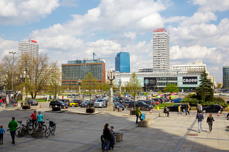 municipal editorial: WARSAW, POLAND - APRIL 16, 2016: The urban complex of buildings along the street Marszalkowska in the downtown, built in the years 1962-1969 consists of skyscrapers, malls and lower buildings Editorial