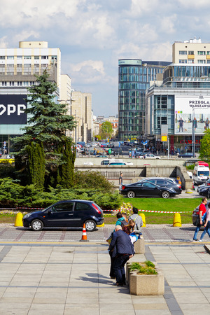 approx: WARSAW, POLAND - APRIL 16, 2016: View showing an ordinary scene in downtown in the largest city in terms of population (approx. 1.7 million inhabitants) in the country Editorial