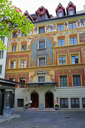 balances: LUCERNE, SWITZERLAND - MAY 02, 2016: A fascinating work painted in 1893 by Seraphin Weingartner on the facade of The Hotel des Balances that is located in heart of the old city