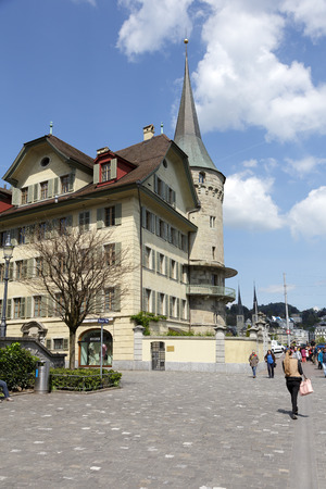 LUCERNE, SWITZERLAND - MAY 04, 2016: Haus zur Gilgen, one of the oldest stone houses in the city and is located on the right bank of the river Reuss. Editorial
