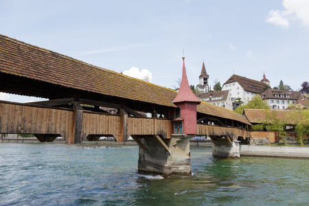 extant: LUCERNE, SWITZERLAND - MAY 04, 2016: Spreuer Bridge (Spreuerbrucke) was built in 1408, restored after flood in 1566, formerly also Muhlenbrucke. It is one of two extant wooden footbridges in the city Editorial