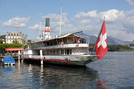 LUCERNE, SWITZERLAND - MAY 04, 2016: Wilhelm Tell steamship, built in 1908, then restored to its original splendor, nowadays is permanently anchored and invites on board to the well known restaurant